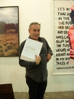 Olivier Debroise with one of the Free Art Gallery works, FEMACO, 2008